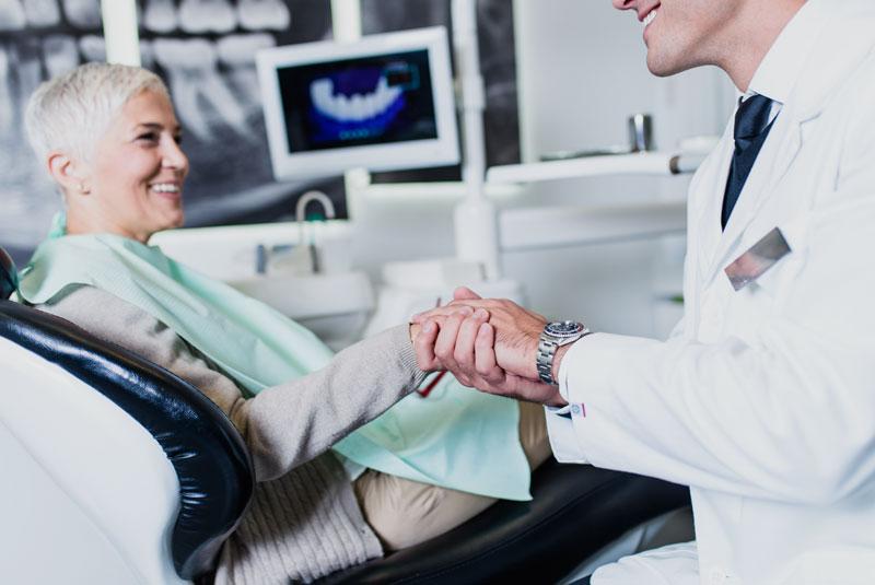 dental implants patient smiling after procedure