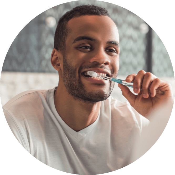 dental patient brushing his teeth