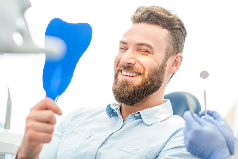 dental patient smiling after orthodontics procedure