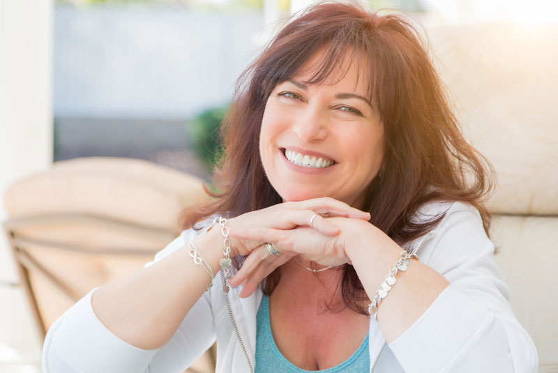 Patient Smiling After Dental Implant Procedure